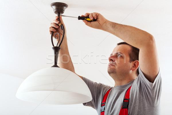 Eletricista teto lâmpada fios máscara Foto stock © lightkeeper