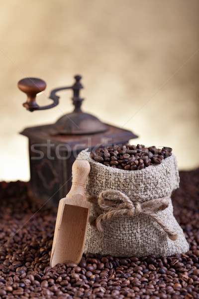 A bag of fresh roasted coffe and old grinder Stock photo © lightkeeper