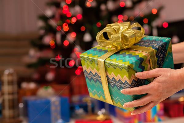 Noel hediye kadın el dekore edilmiş ağaç Stok fotoğraf © lightkeeper