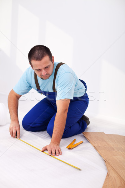 Man laying laminate flooring Stock photo © lightkeeper