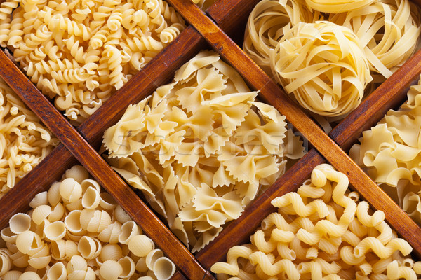 Assorted pasta in wooden compartments Stock photo © lightkeeper