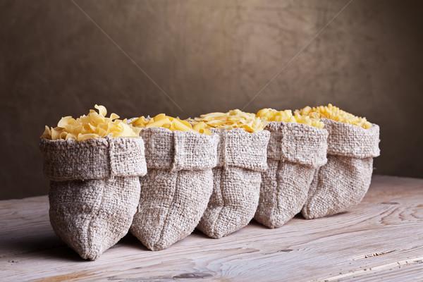 Cinquième pâtes assortiment toile de jute vieux table en bois Photo stock © lightkeeper