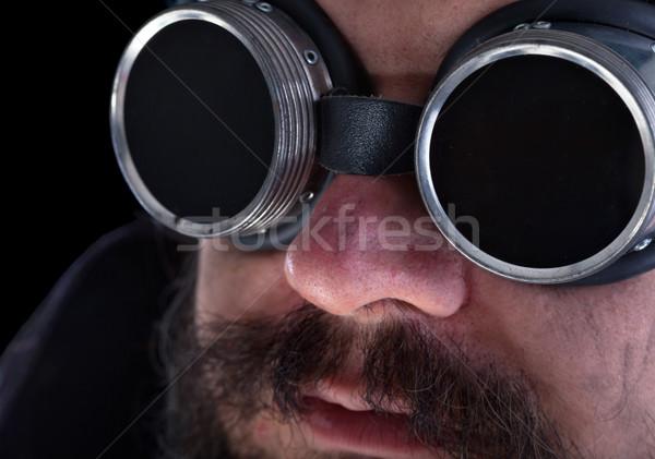 Barbudo homem soldagem óculos de proteção sujo Foto stock © lightkeeper