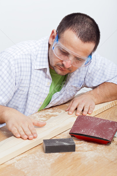 Man furbishing wooden planck Stock photo © lightkeeper