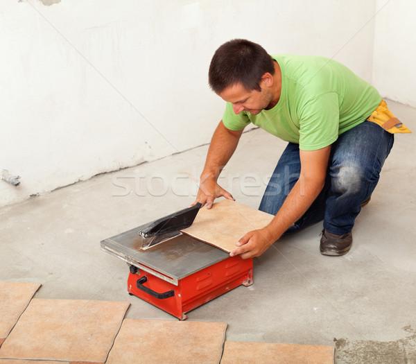 Man cutting ceramic floor tile Stock photo © lightkeeper