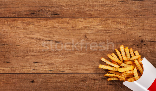 French fries on wooden table - large copy space Stock photo © lightkeeper