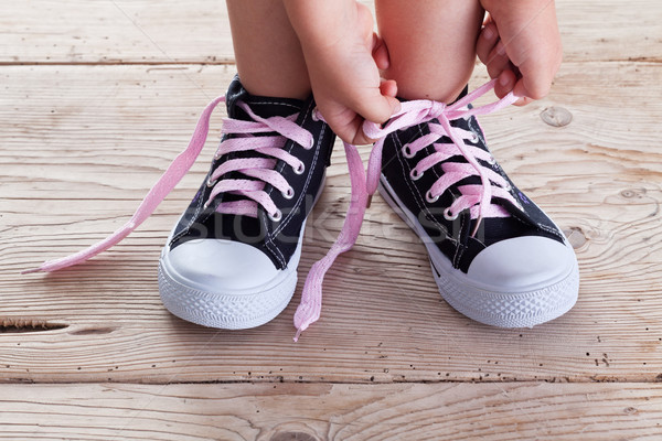 Child hands tie up shoe laces Stock photo © lightkeeper
