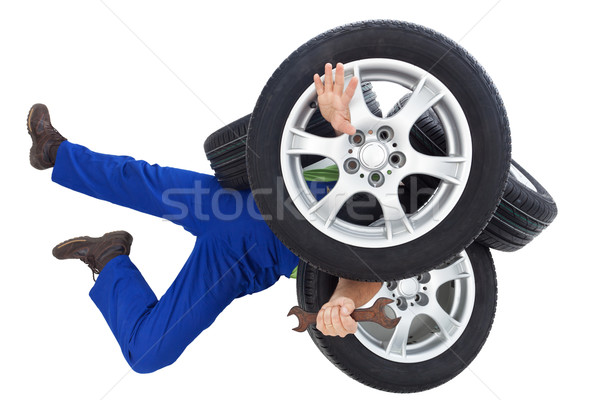 Mechanic covered by car tires Stock photo © lightkeeper
