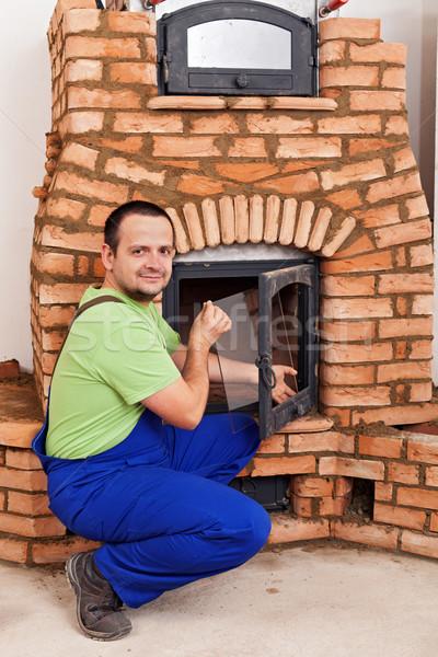 Mason building masonry heater Stock photo © lightkeeper