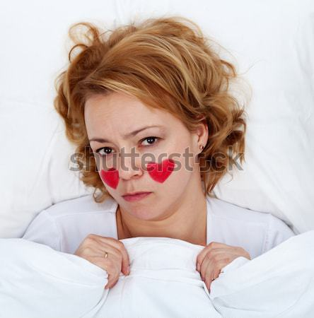 Lovesick woman laying in bed Stock photo © lightkeeper