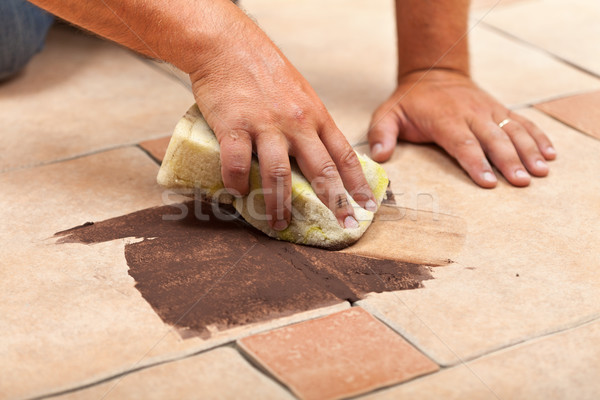 Laying ceramic floor tiles - testing the color of joint Stock photo © lightkeeper