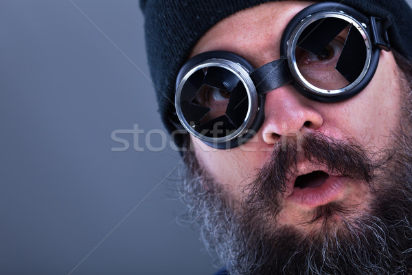Strange beard man viewing explosive situation or offer - closeup Stock photo © lightkeeper