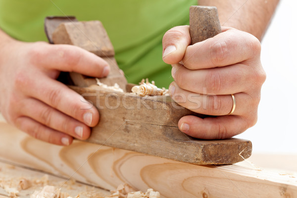 Worker hands closeup - planing wood Stock photo © lightkeeper
