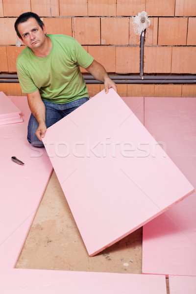 Laying insulation layer in a new house Stock photo © lightkeeper