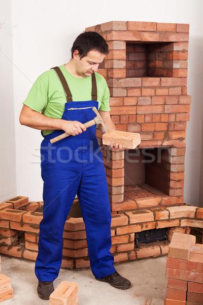 Człowiek budynku kamieniarstwo cegły dopasować Zdjęcia stock © lightkeeper