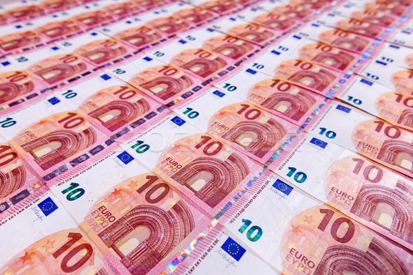 Kicsi tíz Euro bankjegyek pénz átló Stock fotó © lightkeeper