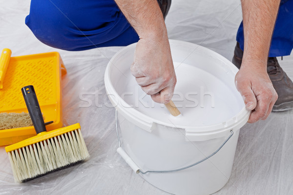 Stirring up paint Stock photo © lightkeeper