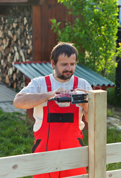 Man building a fence Stock photo © lightkeeper