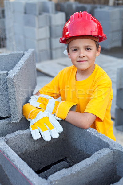 Boy learning the tricks of trade at a construction site Stock photo © lightkeeper