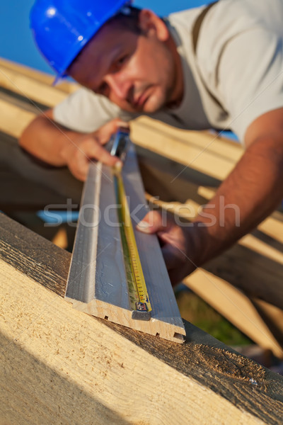 Builder carpenter measuring wood planck Stock photo © lightkeeper