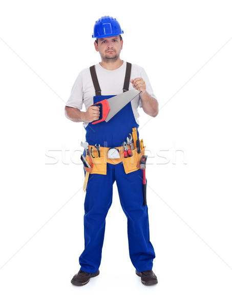 Construction worker with handsaw and other tools Stock photo © lightkeeper