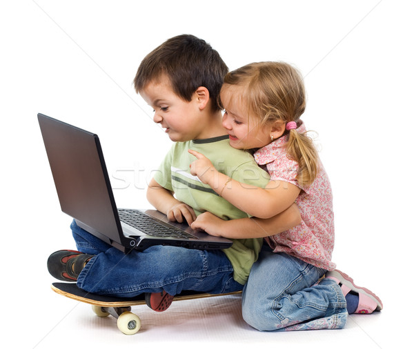 Kids with laptop playing Stock photo © lightkeeper