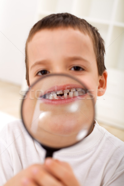 The first lost tooth - boy with magnifier Stock photo © lightkeeper