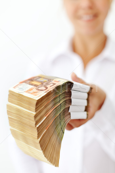 Woman with a stack of euro banknotes Stock photo © lightkeeper