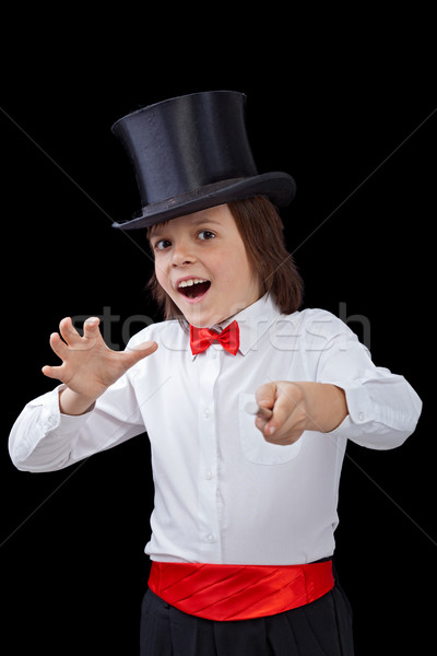 Young magician in the heat of a trick Stock photo © lightkeeper