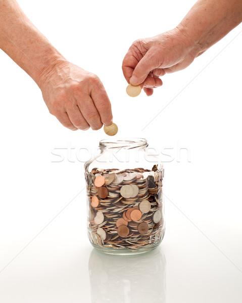 Сток-фото: старший · рук · монетами · стекла · банку