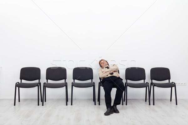 Annoiato deluso dipendente seduta sala di attesa fila Foto d'archivio © lightkeeper