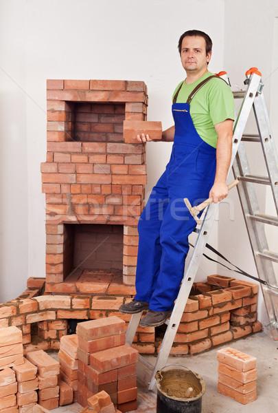 Trabalhador edifício alvenaria aquecedor fogo caixa Foto stock © lightkeeper