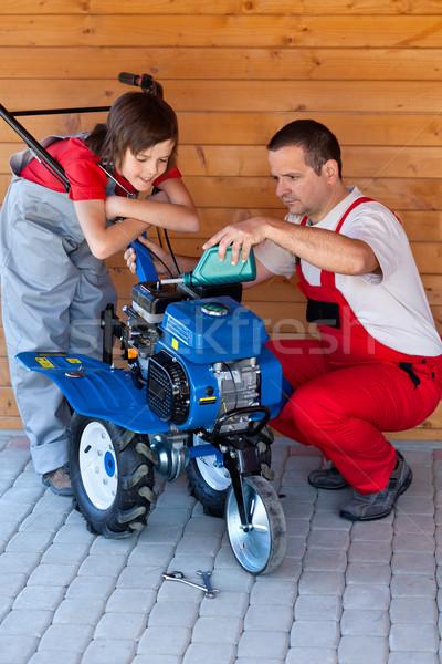 Servicing a small tiller machine Stock photo © lightkeeper