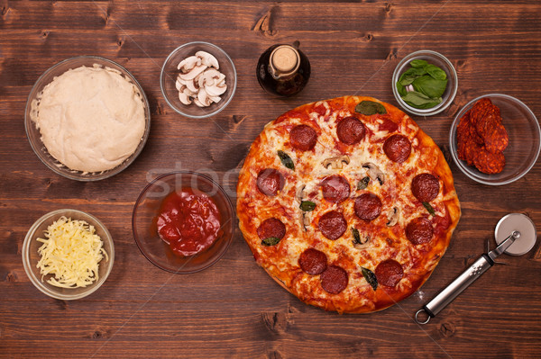 Phases of making a pizza - the baked pizza ready to eat, top vie Stock photo © lightkeeper