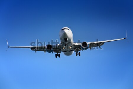 Aeroplane approaching airport Stock photo © lightkeeper