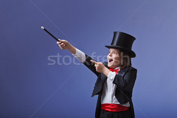 Young magician performing with a magic wand Stock photo © lightkeeper