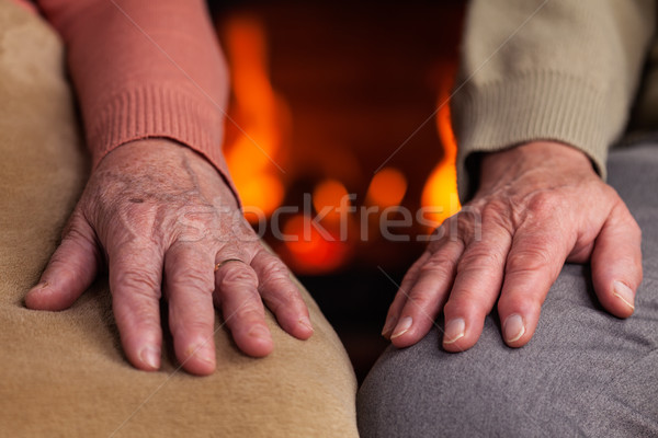 Senior hands resting near the fireplace Stock photo © lightkeeper