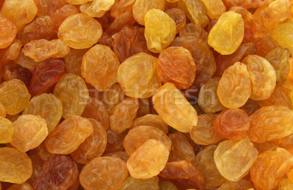 Arany citromsárga mazsola háttér barna fényes Stock fotó © lightkeeper