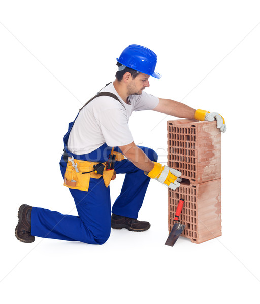 Worker laying bricks - isolated Stock photo © lightkeeper