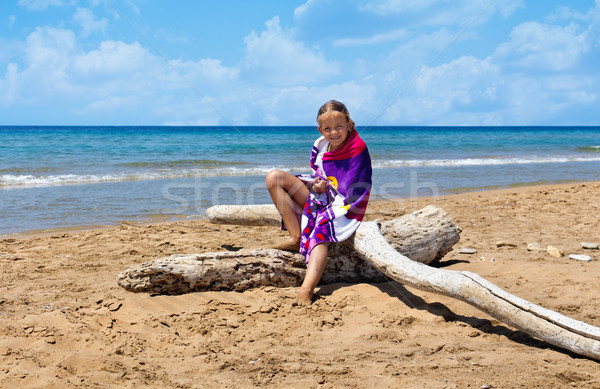 Little girl on the sunny deserted beach Stock photo © lightkeeper