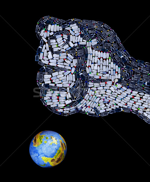 Fist made of plastic bottles crushing the planet Stock photo © lightkeeper
