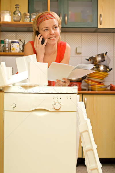 Woman chatting about her new dishwasher Stock photo © lightkeeper