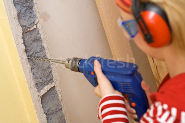 Do it yourself concept - woman with drill Stock photo © lightkeeper