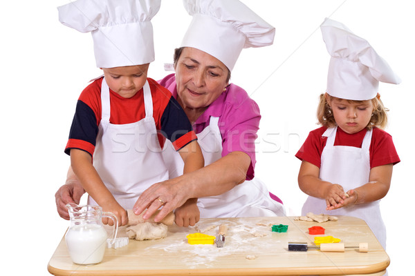 Grandmother teaching kids how to make cookies Stock photo © lightkeeper