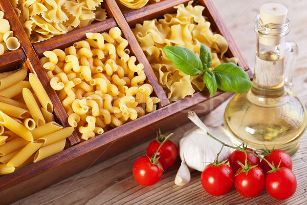 Pasta assortment and seasoning ingredients Stock photo © lightkeeper