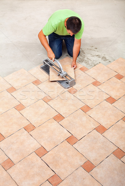 Man laying ceramic floor tiles Stock photo © lightkeeper