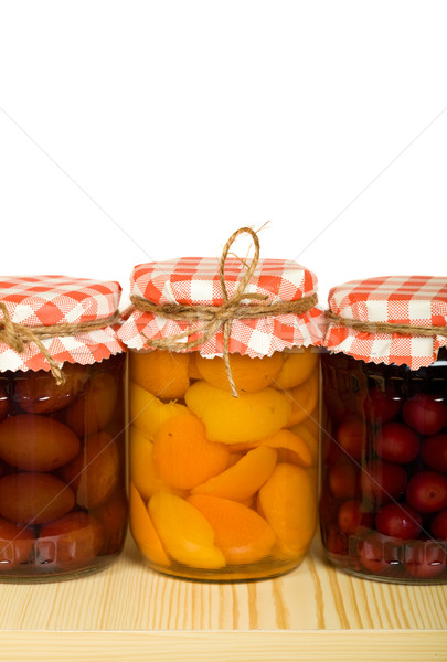 Canned fruits on the shelf - isolated Stock photo © lightkeeper
