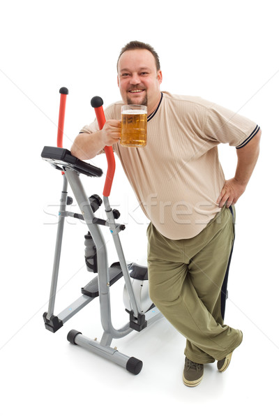 Overweight man having a beer after working out Stock photo © lightkeeper