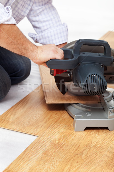 Cutting laminate flooring pieces Stock photo © lightkeeper