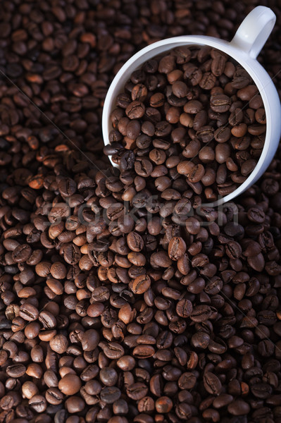Coffee cup covered in beans Stock photo © lightkeeper